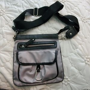 Black and silver cross over bag